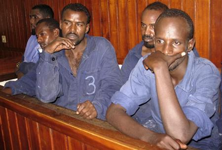 Suspected Somali pirates stand in the dock inside a courtroom in the Kenyan coastal town of Mombasa