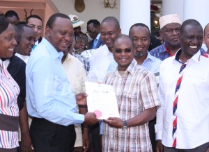 President Kenyatta hands title deed to Kilifi County Governer