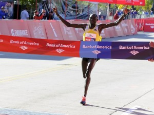Kimmeto crosses the finish line at the Chicago marathon
