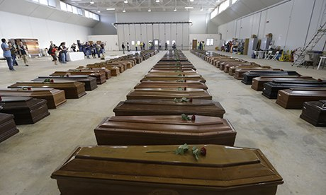 http://www.zegabi.com/articles/wp-content/uploads/2013/11/coffins-at-Lampedusa-airp-001.jpg