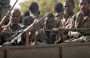 Ethiopian troops ride on a military truck in Somali's capital Mogadishu