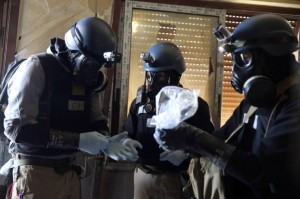 U.N. chemical weapons expert holding a plastic bag containing samples from one of the sites of an alleged chemical weapons