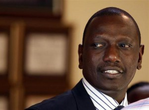 Former Kenyan Cabinet Minister Ruto stands inside his house after hearing the news from the International Criminal Court, in Nairobi